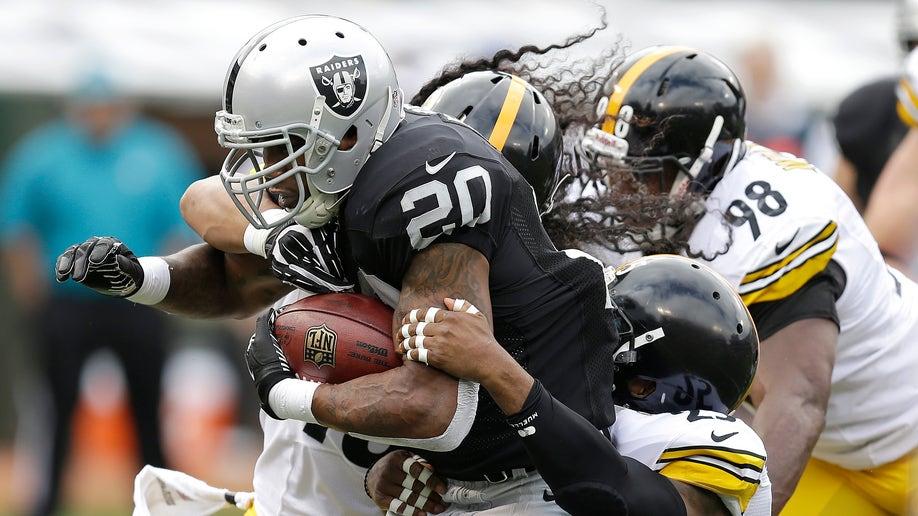 ef810926-APTOPIX Steelers Raiders Football