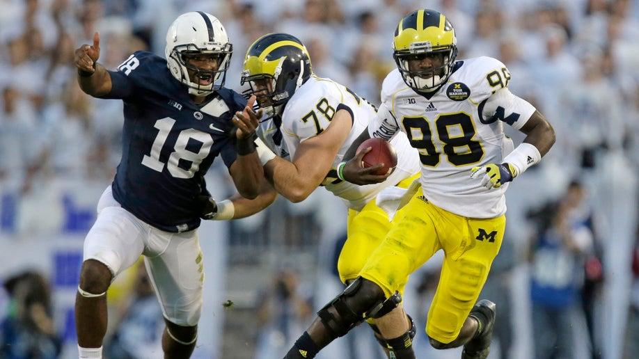 5a9cbdac-Michigan Penn St Football