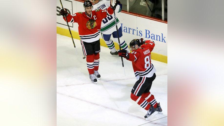f5a519c8-Canucks Blackhawks Hockey
