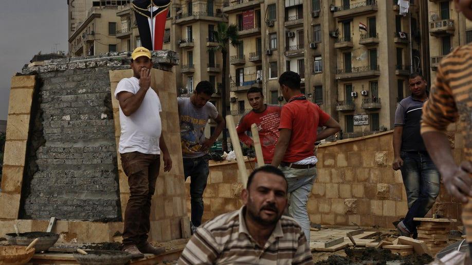 67ead833-Mideast Egypt Tahrir Memorial