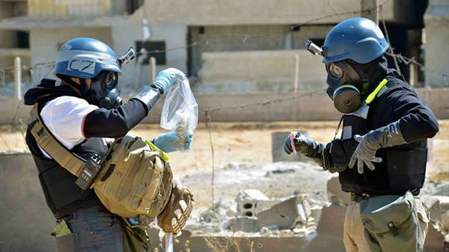 f576f059-Mideast Syria Chemical Weapons News Guide