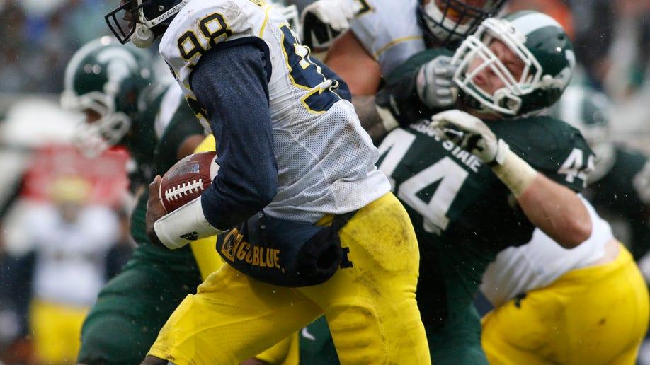 a4b44705-Michigan Michigan St Football
