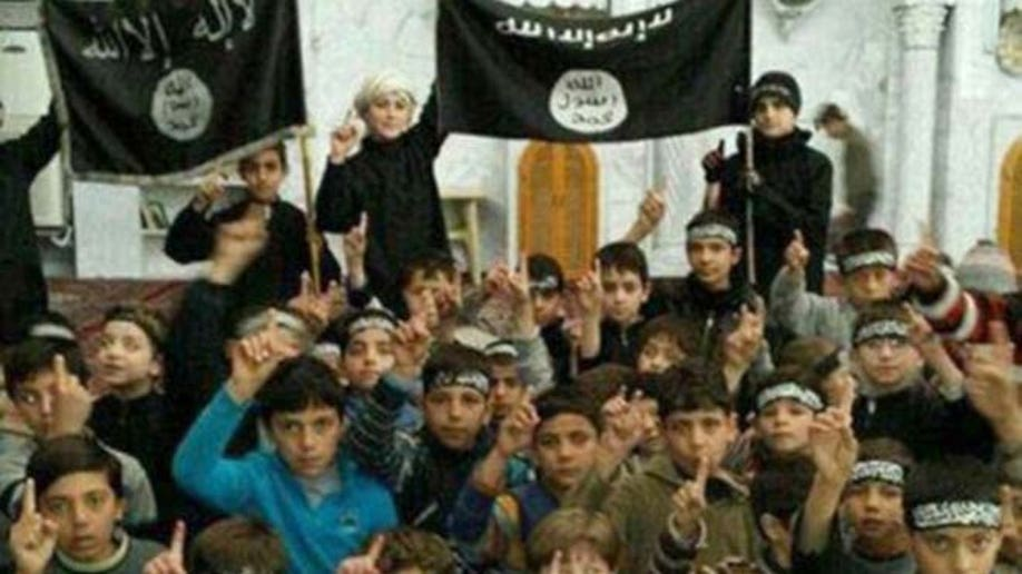 d3c88576-Mideast Islamic State Child Soldiers