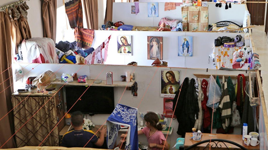 cd17e4d6-Mideast Jordan Iraqi Christians