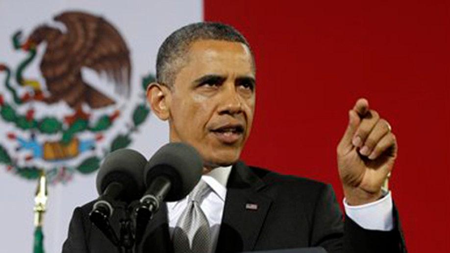 b1385da6-Obama US Mexico