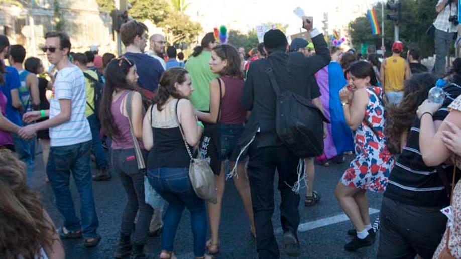 APTOPIX Mideast Israel Gay Parade Attacking