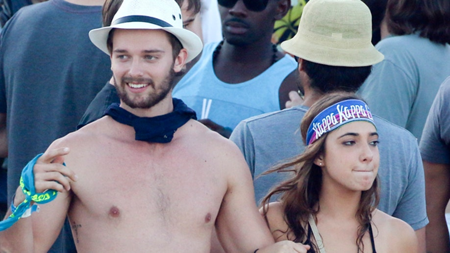 299fb84c-EXCLUSIVE: **PREMIUM RATES APPLY** Patrick Schwarzenegger spends time in a Irish Bar for spring break in Cabo, surrounded by pretty girls
