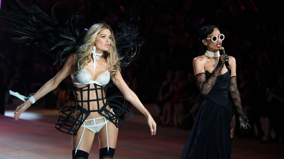 22f3679af1 0c820599-. next. Image 1 of 3. Rihanna and a Victoria s Secret model at the 2012  Victoria s Secret fashion show.