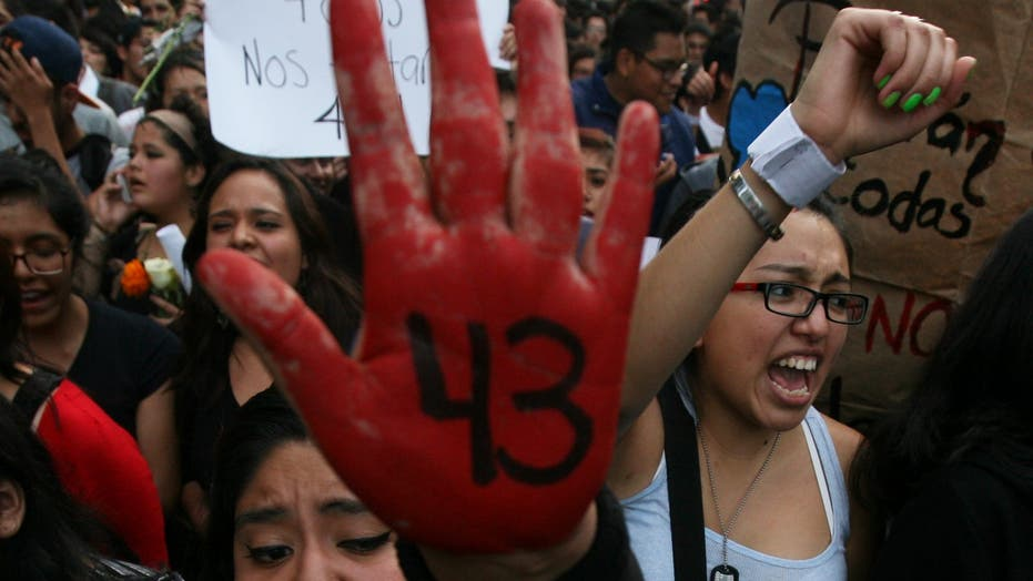 Mexico searches for 43 missing students, finds dozens of – other – bodies
