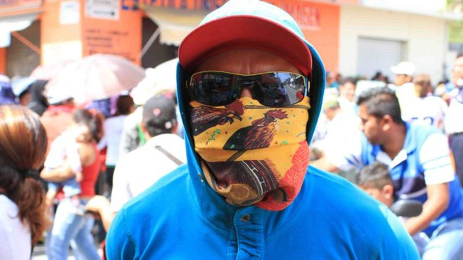 Iguala residents take to the streets imploring: 'We want the students back alive!'