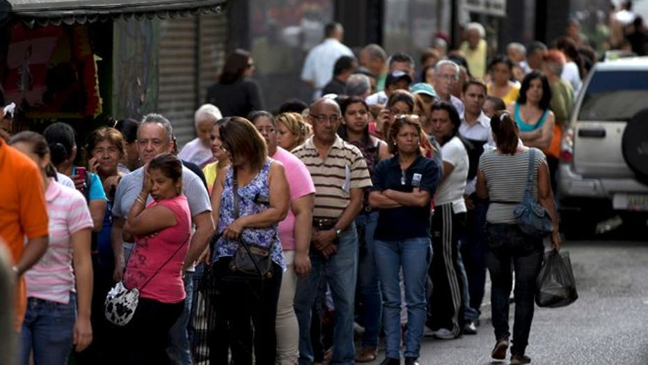 Venezuelans face extreme shortages with long line and strict quotas