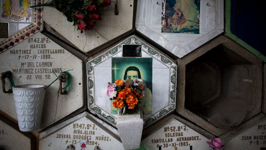Cramped Mexico City residents face even more crowded conditions in cemeteries