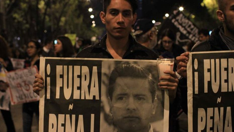 Mexico City demonstrators call for justice for missing students, Pres. Peña Nieto's resignation