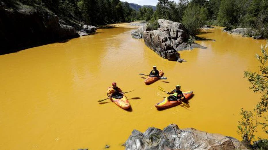 A river runs yellow: Mine waste colors the Animas River
