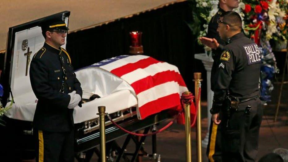 Law enforcement, Navy personnel mourn slain Dallas officer