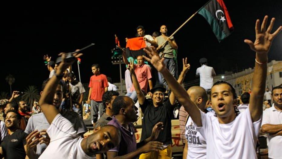 Libyan Rebel Fighters Take Tripoli
