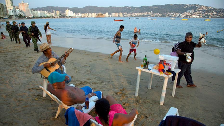 Police, soldiers swarm Mexico's Acapulco, killings continue