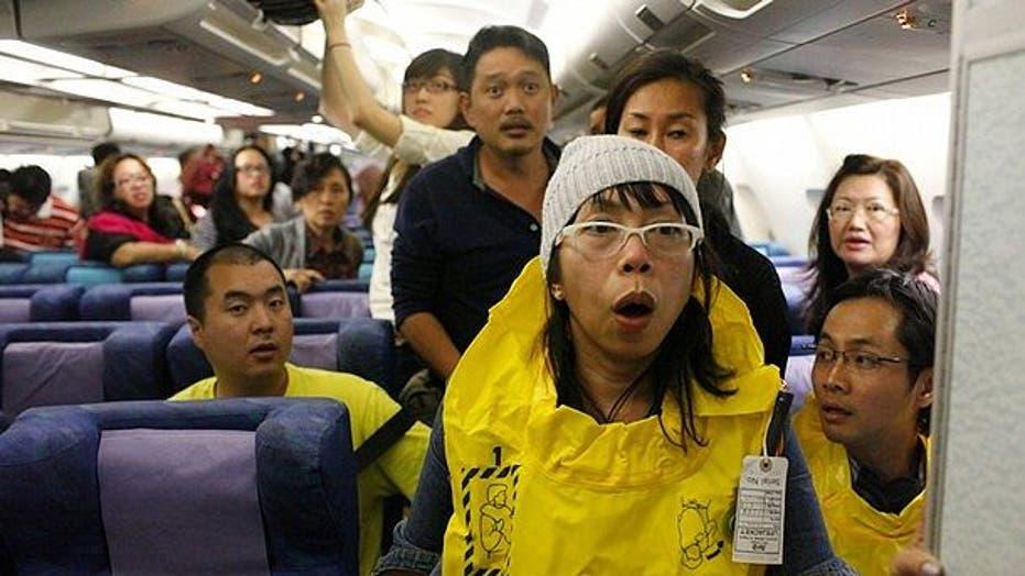 Passengers Pray as Plane Makes Fiery Landing in Singapore