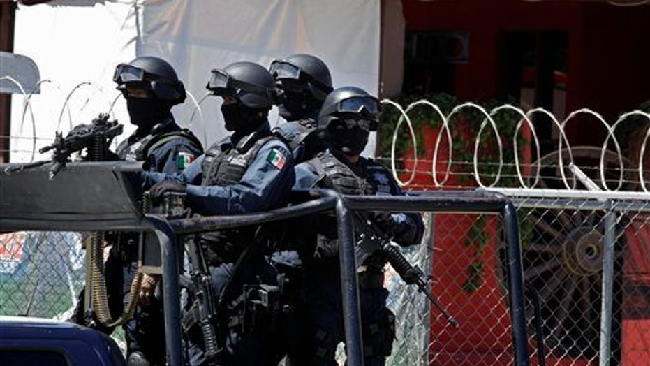Mexican Police Investigate Mass Graves