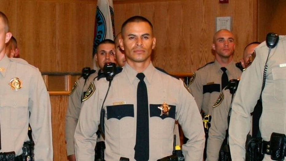 Thousands turn out to honor slain New Mexico police officer