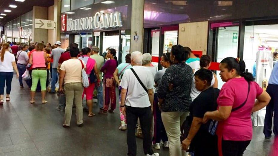 Despite government efforts, Venezuelans still spend long hours waiting for goods