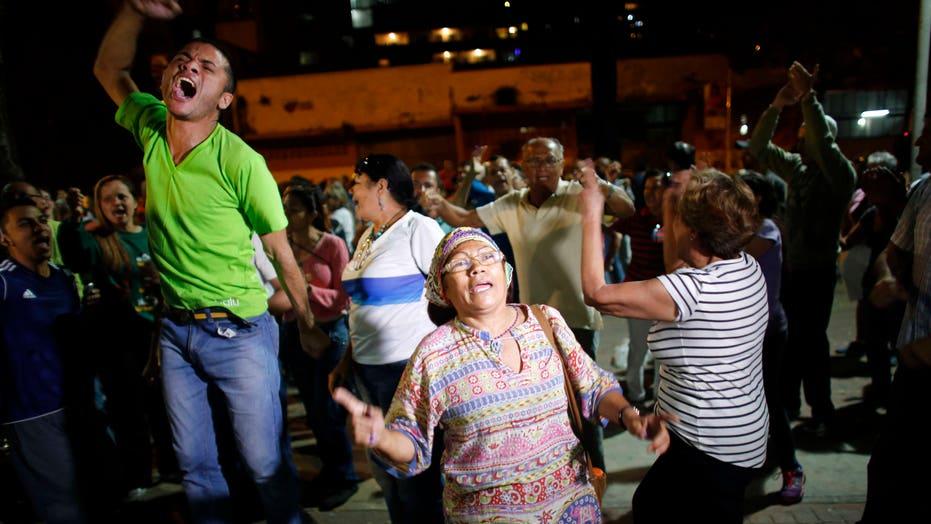 Venezuela's opposition celebrates landslide win in historic election