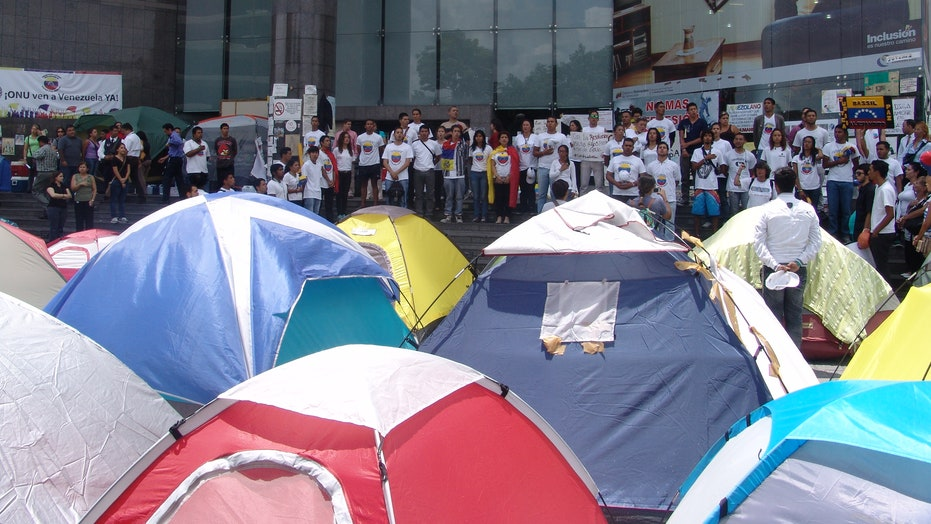 Determined To Not Settle, Venezuelan Students Settle Outside U.N. Offices In Caracas