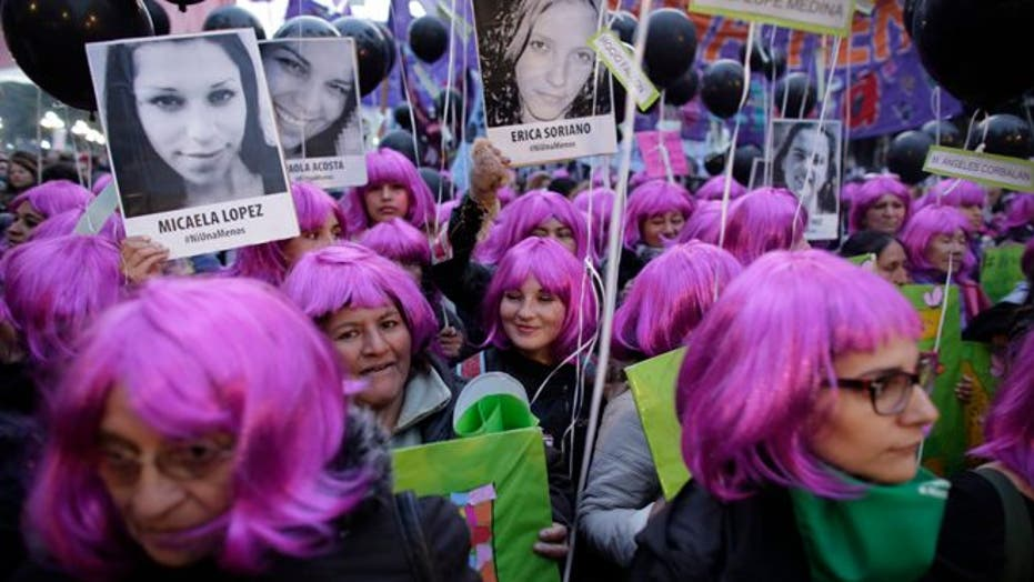 Demonstrators take to streets of Buenos Aires to protest violence against women