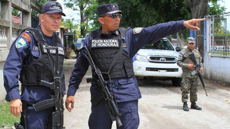 A look at how police patrol, and people live in, a country torn apart by gang wars