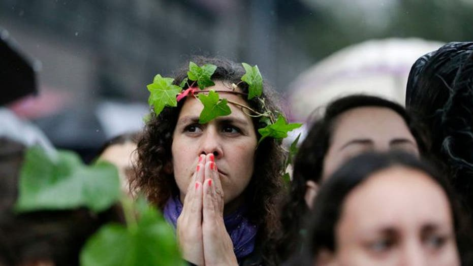 Thousands brave rain and come out to decry violence against women