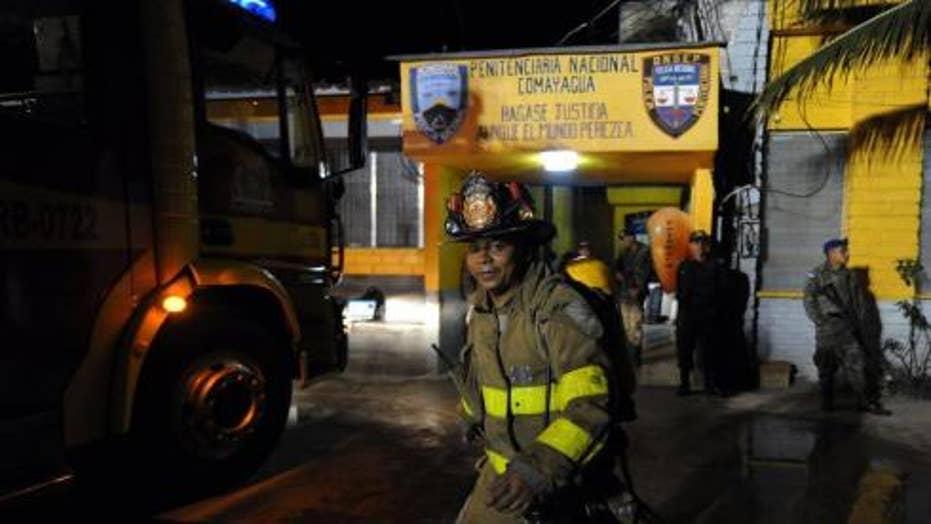 'Hellish' fire at Honduras prison kills hundreds