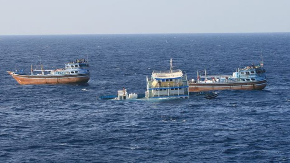 Navy ship aids sinking Iranian fishing dhow