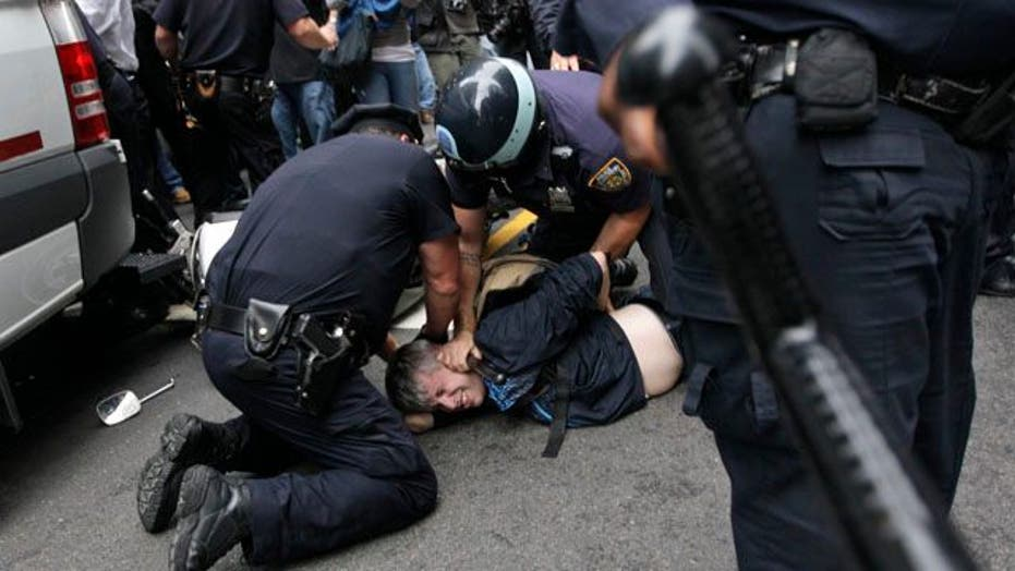 Wall Street Protesters, Police Clash in New York, Denver
