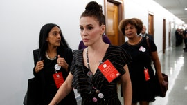 Alyssa Milano doubles down on calling Trump MAGA hats 'the new white hood'