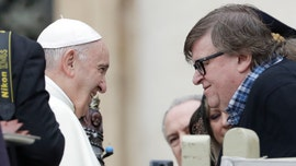 Michael Moore 'deeply moved' after meeting with Pope Francis