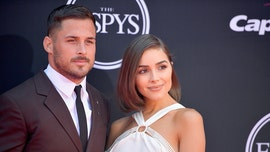 Olivia Culpo says she isn't looking to rebound at CMAs after breakup with Danny Amendola