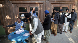 The Latest: Afghan official outraged by polls' chaotic start