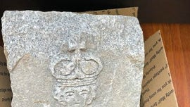 Strange carved stone found 'buried' under New Jersey river puzzles locals