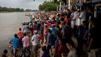 Migrant caravan showdown: Crowds reach Guatemalan border town as Mexico prepares for potential mass crossing