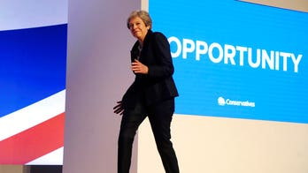 British prime minister Theresa May dances on stage to ABBA at Conservative conference