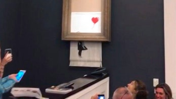 Banksy painting renamed 'Love is in the Bin' after shredding during live auction