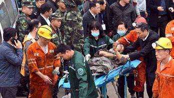 China coal mine explosion kills 2, leaves 18 trapped