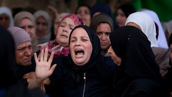 Palestinians bury woman killed in West Bank, 7 slain in Gaza