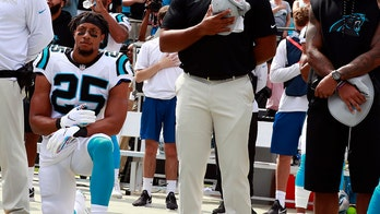 Eric Reid takes a knee during national anthem in first game as Carolina Panthers player