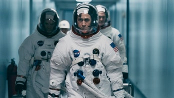 'First Man' opens at No. 3 after flag controversy, fails to topple 'Venom' and 'A Star is Born'