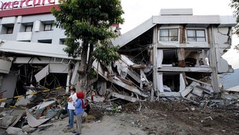 No more signs of life in Indonesia hotel rubble, rescuers say