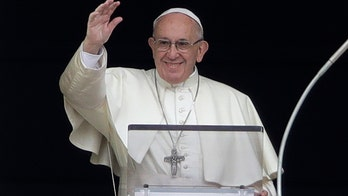 Pope lights candle to promote peace in Syria