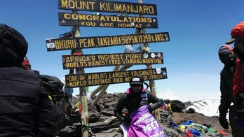 Mom who lost hands, feet to sepsis climbs Kilimanjaro