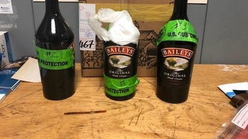Man arrested at JFK Airport after trying to smuggle $115,000 of cocaine in Bailey's bottles, officials say