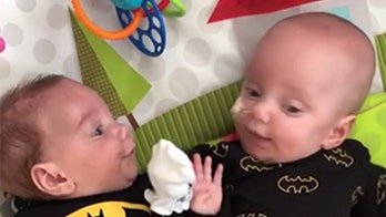 'Miracle' twins head home after beating incredible odds